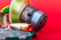 Wobbler, reel, fishing line in bright color.