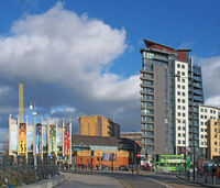 a view of the creative quarter in leeds taken from eastgate showing west yorkshire playhouse and the skyline apartments building next to the BBC headquarters