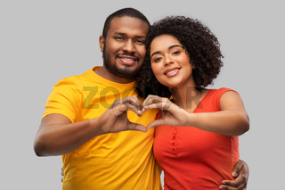 happy african american couple making hand heart
