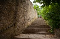 An old stone staircase leading to the sights.