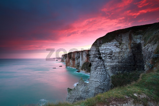 dramatic sunrise over cliffs in Atlantic ocean