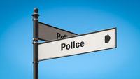 Street Sign to Police