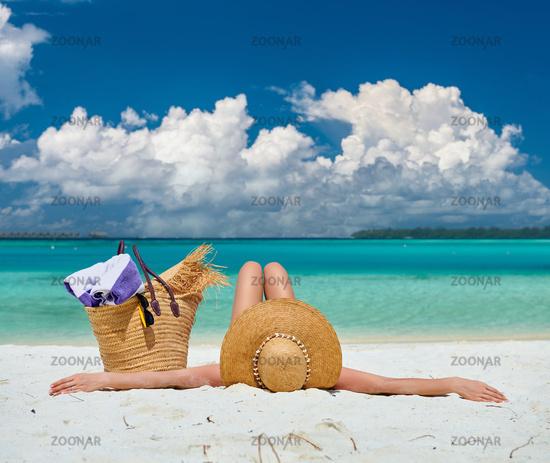 Woman lying down on beach