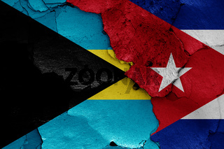 flags of Bahamas and Cuba painted on cracked wall