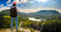 Hiker woman standing on top of the mountain. Beautiful Nature Norway Tourism, vacation and traveling