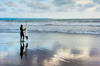 Surfer silhouette beach blue Bali