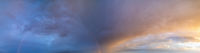 Summer sunset after rain sky panorama with fleece purple clouds and rainbow. Evening dusk good weather natural cloudscape background.