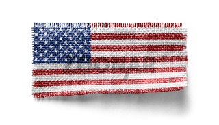 USA flag on a piece of cloth on a white background