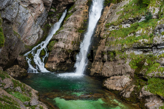 The amazingly beautiful iconic Savica Waterfall in the Triglav national park in Slovenia in the slovenian alps near Lake Bohinj on overcast cloudy day