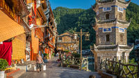 Woman carrying heavy load in Fenghuang