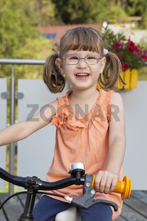 Happy little girl on bike