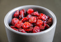 Cranberries in a bowl on a kitchen table