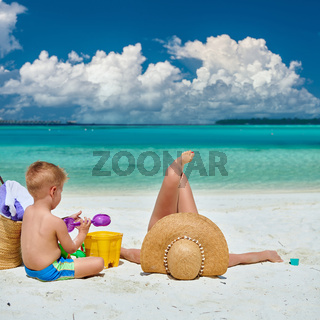Woman with three year old boy on beach