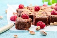 Brownie slices with dark chocolate, raspberries and sea salt.