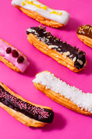 Several eclairs with different colored types of fillings