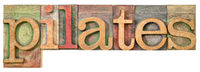 pilates - isolated word abstract in wood type