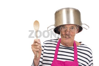 Houseman with pink apron and cooking pan on his hat