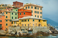 Old houses on the coast by the sea in Genoa
