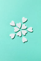 Valentine's flowers pattern made from small hearts with shadows.
