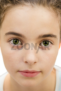 Closeup portrait of a beautiful young girl, with big green eyes looking into the camera, isolated on white