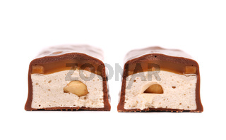 Slices bar of chocolate with filling.