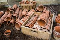 old clay flower pots in old wooden box