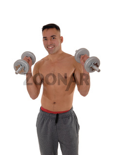 Close-up of a man with two dumbbells working out