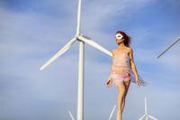 Sexy Topless Redhead Model Posing Outdoors With Wind Turbines In The Background