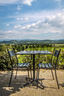 Seating area in the cafe with a view of the Provence countryside