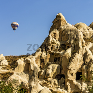 Balloon Over Rock Houses Cappadocia Turkey
