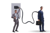 Businessman being powered by electricity and plug