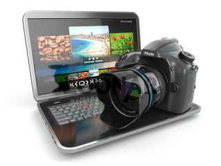 Digital photo camera and laptop. Journalist  or  traveler equipment.