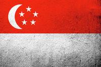 the Republic of Singapore National flag. Grunge background