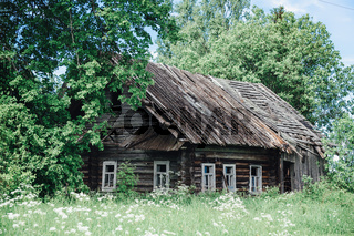 Old crumbling abandoned house among the trees