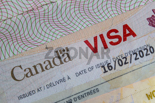 A Close up of a Canada VISA on a passport inside page