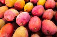 red stacks of mango fruits