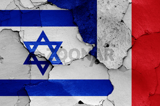 flags of Israel and France painted on cracked wall