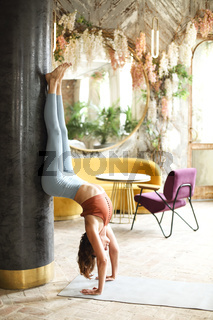 Slim woman doing yoga at home