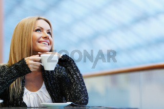 Lady drinking afternoon coffee