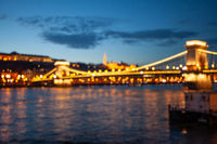 Blurred Budapest chain bridge on danube river. Famous sights at landmark Buda riverbank.