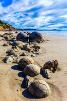 Boulders Moeraki on a sandy beach