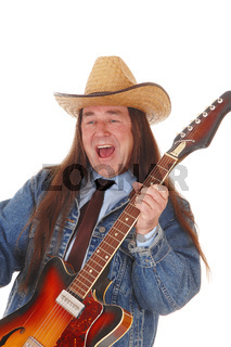 Middle age man standing playing the guitar and singing