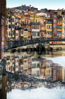 Colorful houses on both sides of the river Onyar