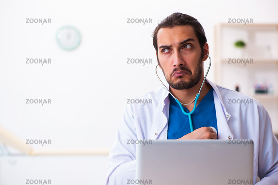 Young male doctor holding phonendoscope