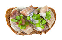 top view of open sandwich with herring and onion
