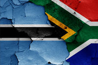 flags of Botswana and South Africa painted on cracked wall