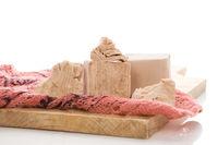 Fresh yeast blocks on wooden board.