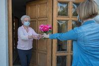 Senior face mask gets flowers.jpg
