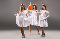 Showgirls in sexy medicine costumes shot