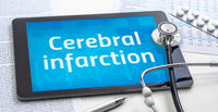 The word Cerebral infarction on the display of a tablet